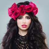 Brunette Fashion Model with Makeup and Roses Flowers Royalty Free Stock Photo