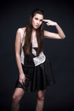 Brunette fashion model posing in studio Royalty Free Stock Photos