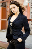 Brunette Fashion Model in semi casual professional clothes Stock Photos