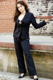 Brunette Fashion Model in semi casual professional clothes Royalty Free Stock Image