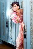 Brunette fashion woman retro vintage in wardrobe. And spring pink flowers dress Royalty Free Stock Image