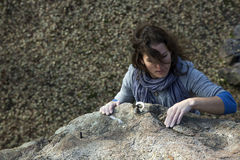 Brunette female climber with strand of hair Stock Photography