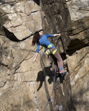 Brunette female climber on the wall Stock Photo