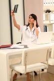 Brunette female Doctor Stock Image