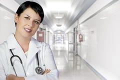 Brunette female doctor on duty Royalty Free Stock Image