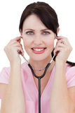 Brunette female doctor using a stethoscope Royalty Free Stock Image