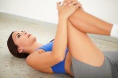 Brunette female exercising pilates for wellbeing Stock Photo