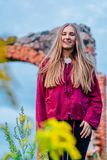 Brunette Female Fashion Model in Countryside Environment with Purple Sweater and Dark Blue Jeans - Sunny Autumn Day royalty free stock images