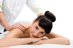 Brunette female getting a massage Royalty Free Stock Photos