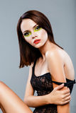 Brunette female model with bright make up Royalty Free Stock Photos