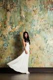 Brunette Female Model in Trendy White Dress Stock Photography