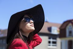 Brunette female portrait looking at the sun Royalty Free Stock Images