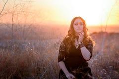 Brunette Female wearing lace dress in field stock photos
