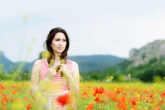 Brunette in field Stock Photos