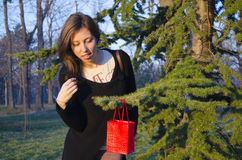 Brunette finding her Valentine's gift on a tree stock photo