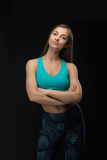 Brunette fitness woman folded her arms. Royalty Free Stock Photos