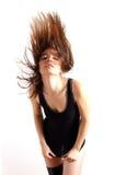 Brunette Flipping Hair. Brunette Model Flipping Long Hair Backwards Stock Photo