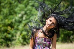 Brunette flipping her hair Royalty Free Stock Photo