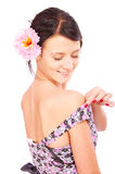 Brunette with flower in hair Stock Photos