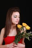 Brunette and flowers. Pretty brunette getting ready for the prom night stock photos