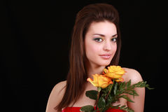 Brunette and flowers. Pretty brunette getting ready for the prom night royalty free stock image