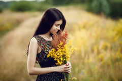 Brunette with flowers Stock Photo