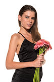 Brunette with flowers Stock Images