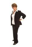 Brunette-Frau mit Rückenschmerzen Stockfoto