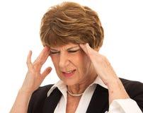 Brunette-Frau mit schmerzlichen Kopfschmerzen Lizenzfreies Stockbild