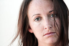 Brunette with freckles. Royalty Free Stock Image