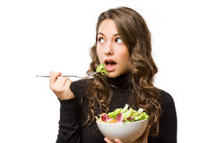 Brunette  with fresh salad. Stock Photography