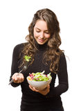 Brunette  with fresh salad. Royalty Free Stock Images