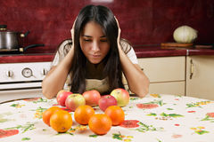 Brunette and the fruits Stock Images