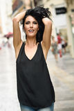 Brunette funny woman wearing casual clothes happy in the street Stock Photo