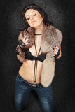 Brunette in fur Stock Images