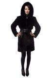 Brunette in fur coat with hood Stock Images