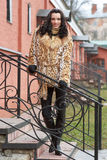 Brunette in furs outdoors Stock Photos