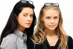 Brunette gegen Blondine Lizenzfreies Stockbild