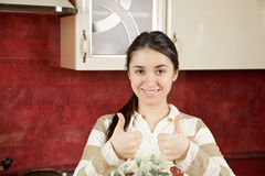 Brunette gesturing both thumbs up Stock Photos