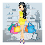 Brunette Gir In Shoes Store Royalty Free Stock Photography