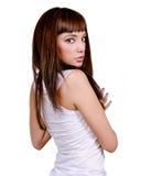 Brunette girl. Isolated on white background stock image