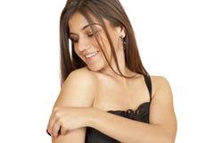 Brunette girl adjusts straps on the shoulder Royalty Free Stock Photos