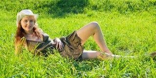 Brunette girl against summer nature Royalty Free Stock Photo