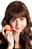 Brunette girl with apple Royalty Free Stock Images