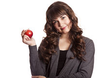Brunette girl with apple in hand. Stock Photo