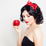 Brunette Girl with Apple. Brunette Girl with Red Apple. Carnival Snow-White character royalty free stock image