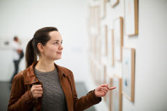 Brunette girl in art museum Stock Photography
