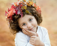 Brunette girl in a autumn crown Royalty Free Stock Photos