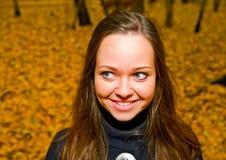Brunette girl in autumn forest Stock Image