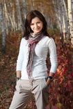 Brunette girl in autumn forest Stock Photos
